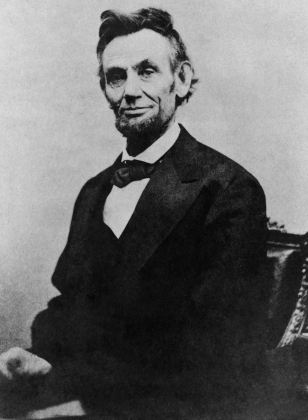 Abraham_Lincoln_half_length_seated,_April_10,_1865