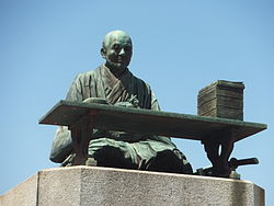 bronze statue of kaibara ekken at his gravesite (kinryū-temple, fukuoka-city, japan)